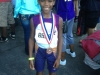 Davon showing off his medal in the 1500m