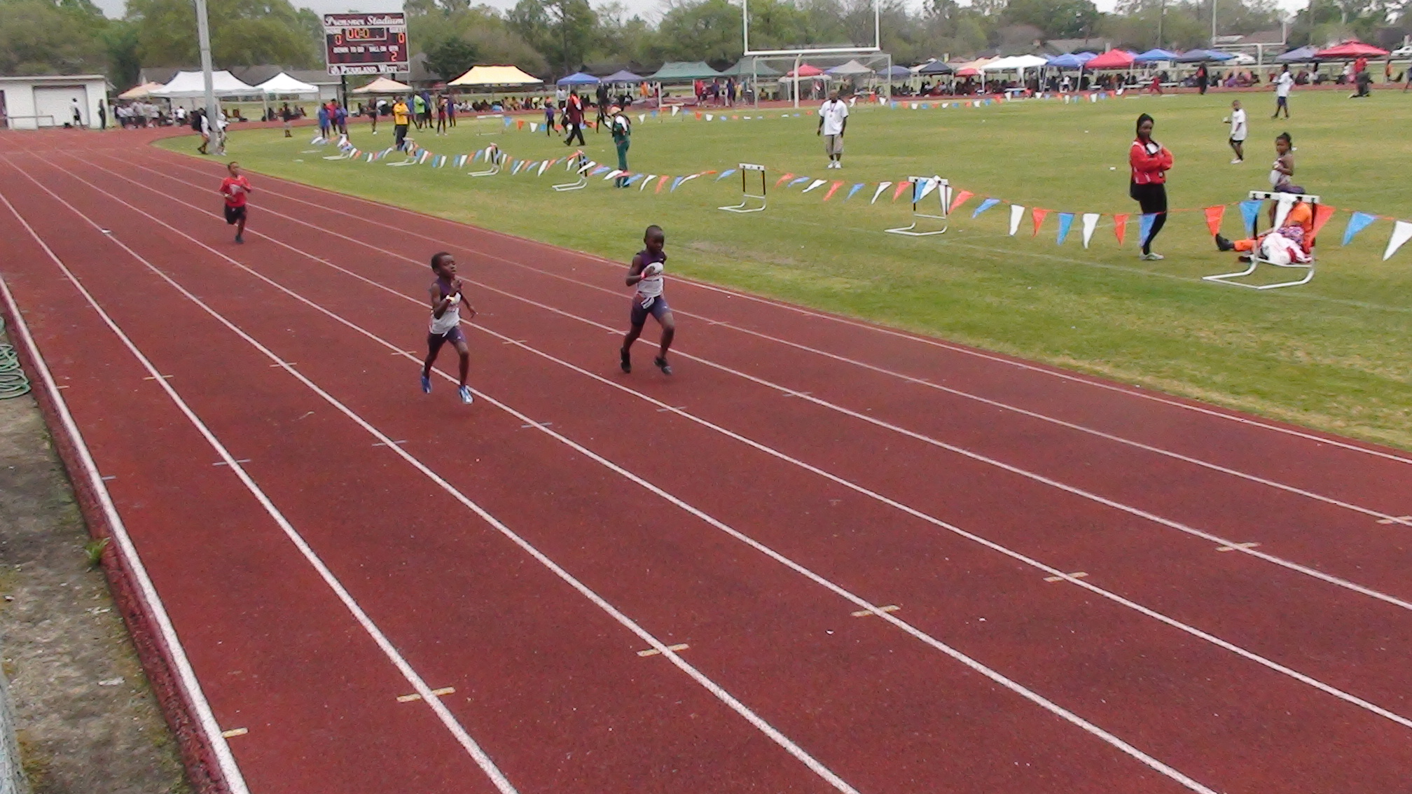 Todd and Demarien running the 200m