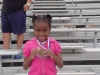 Kyla showing off her medal in the Munchkin Race