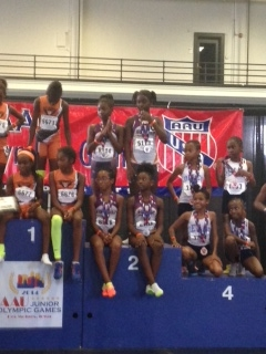 9-10 girls on the podium for 4x400 relay