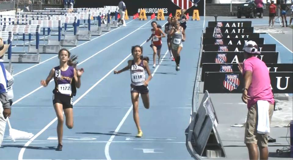 Michelle crosses the line in the 1500m