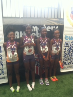 9-10 girls with their 4x400 relay medals