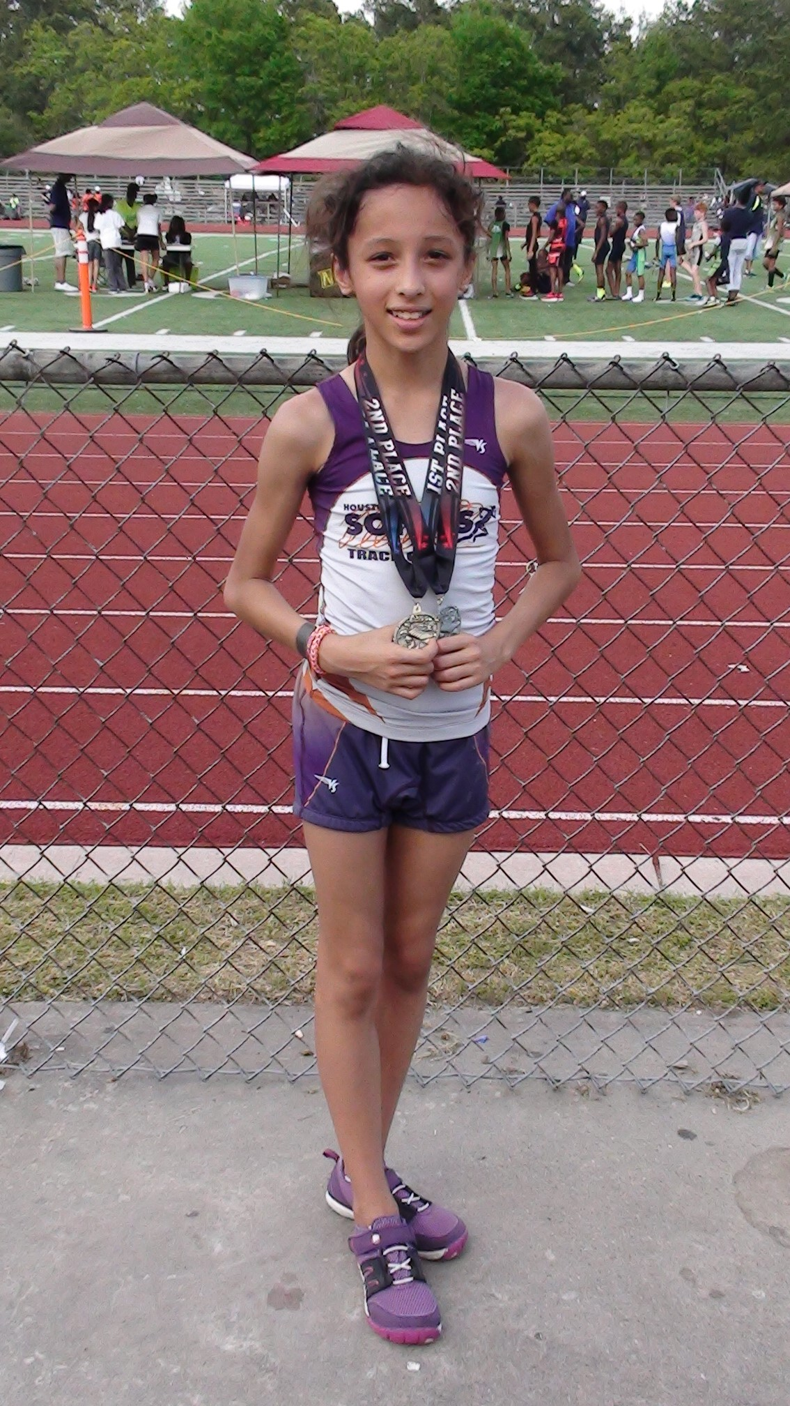 Michelle medaled in 400 and 1500