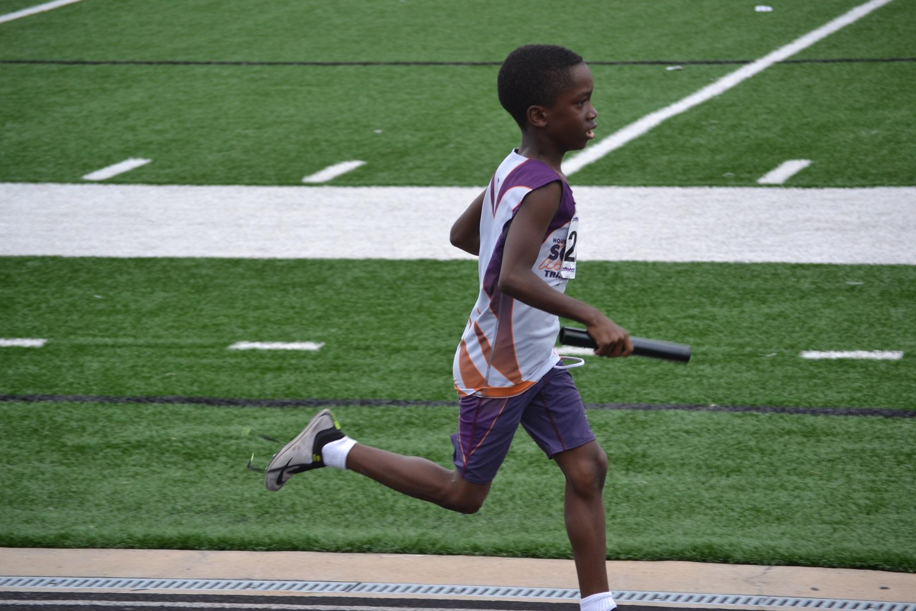 Joshua running the 4x400 relay