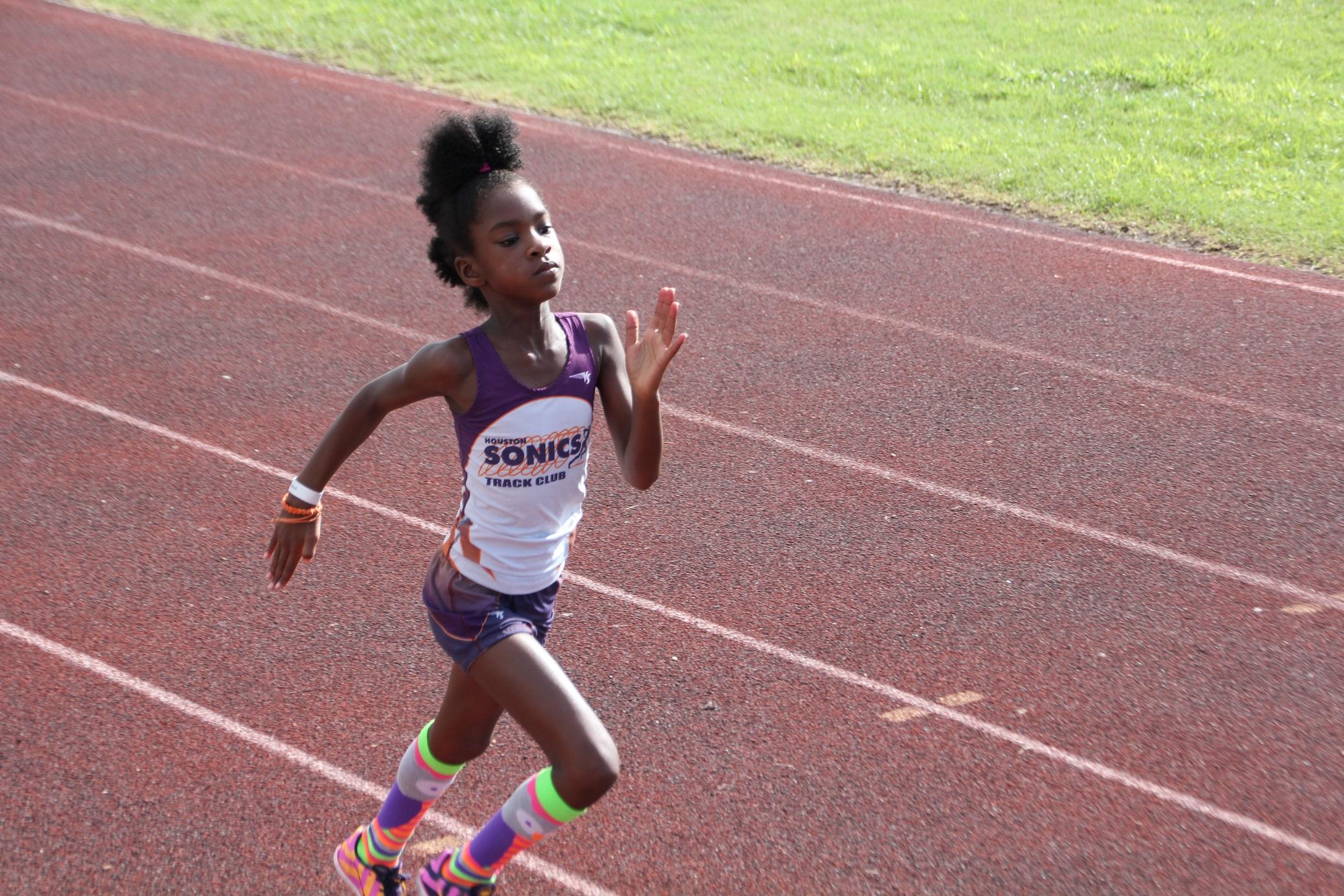 Tia running the 100m
