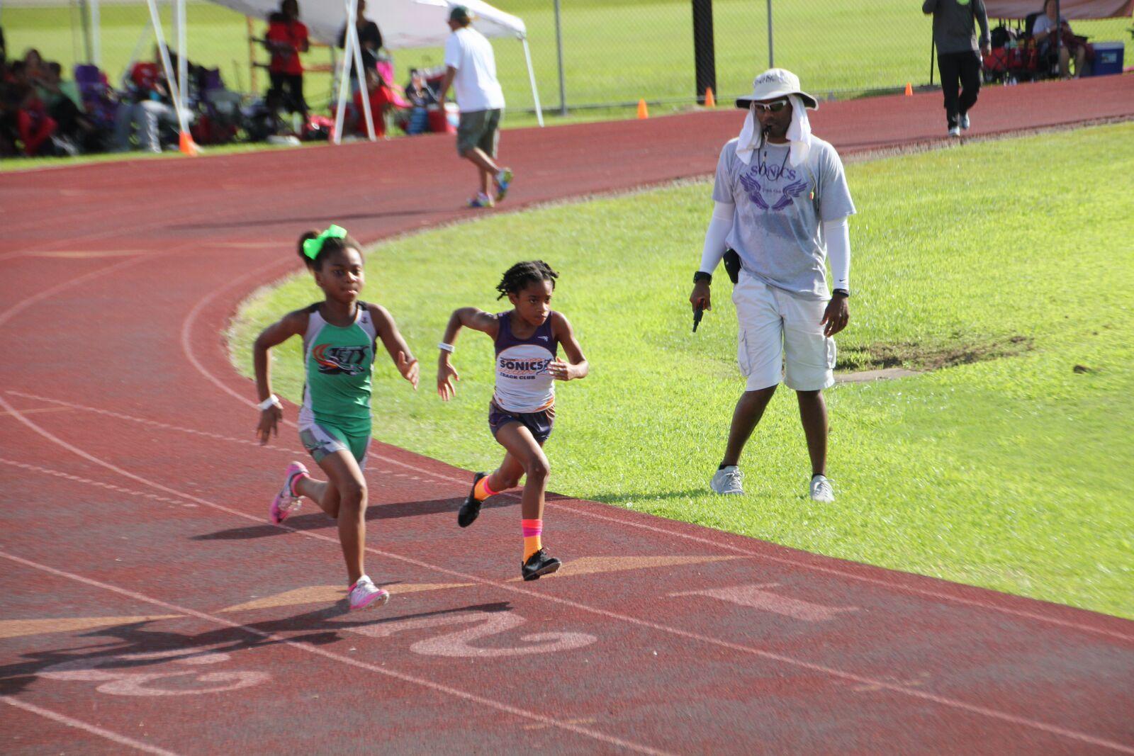 Shakira running the 100m