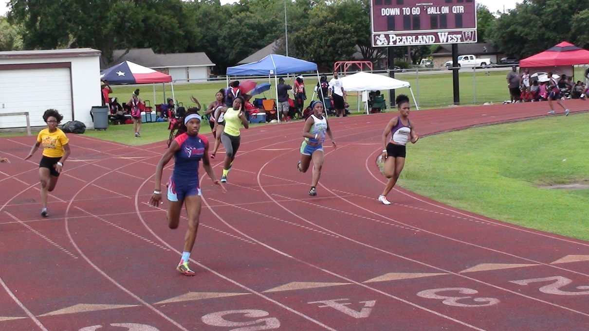 Shania and Mikayla running the 200m