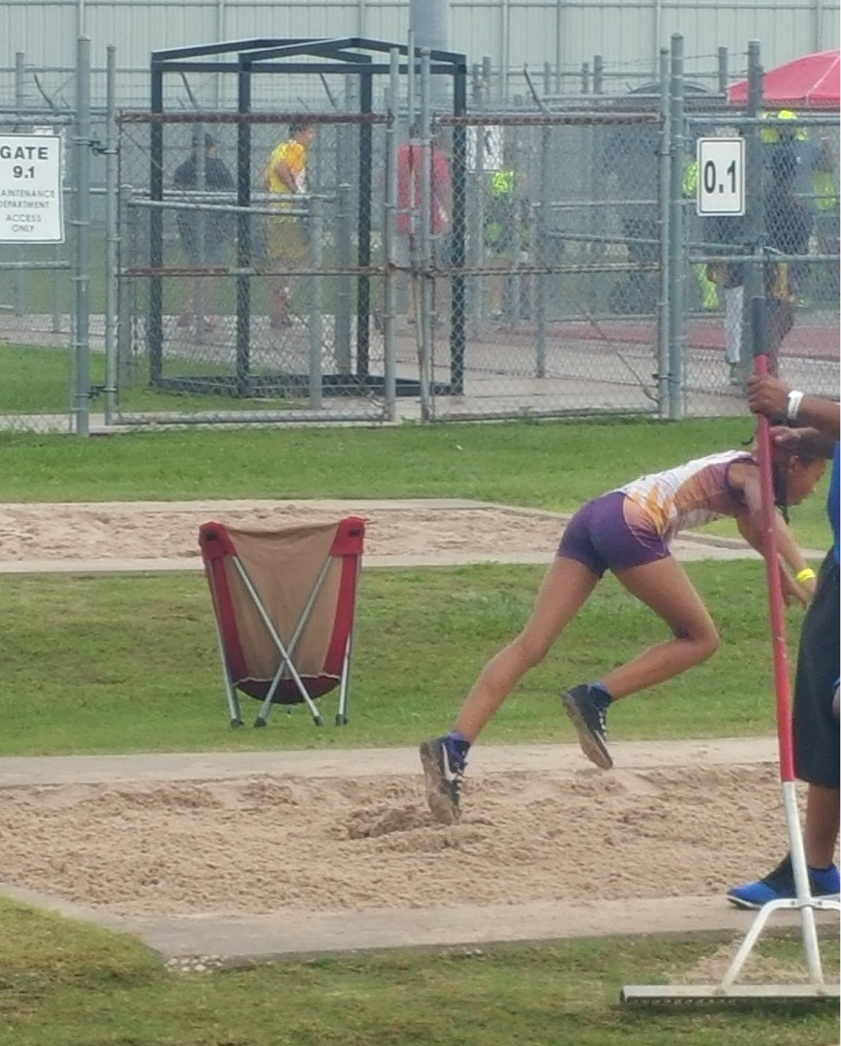 Jayla landing in the long jump pit