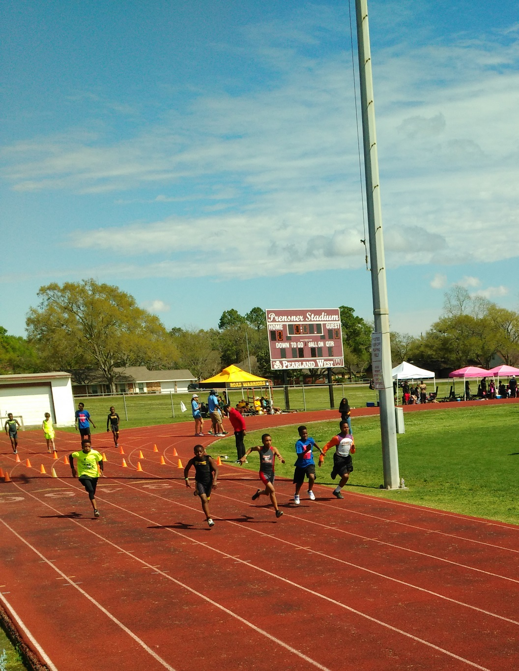 Kenneth running the 100