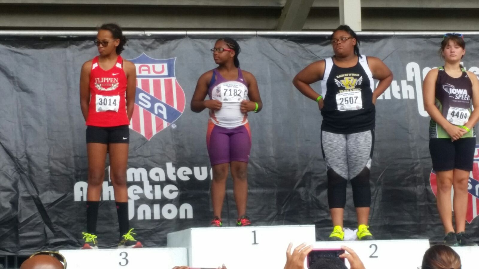 Octavia on the medal podium for the shot put