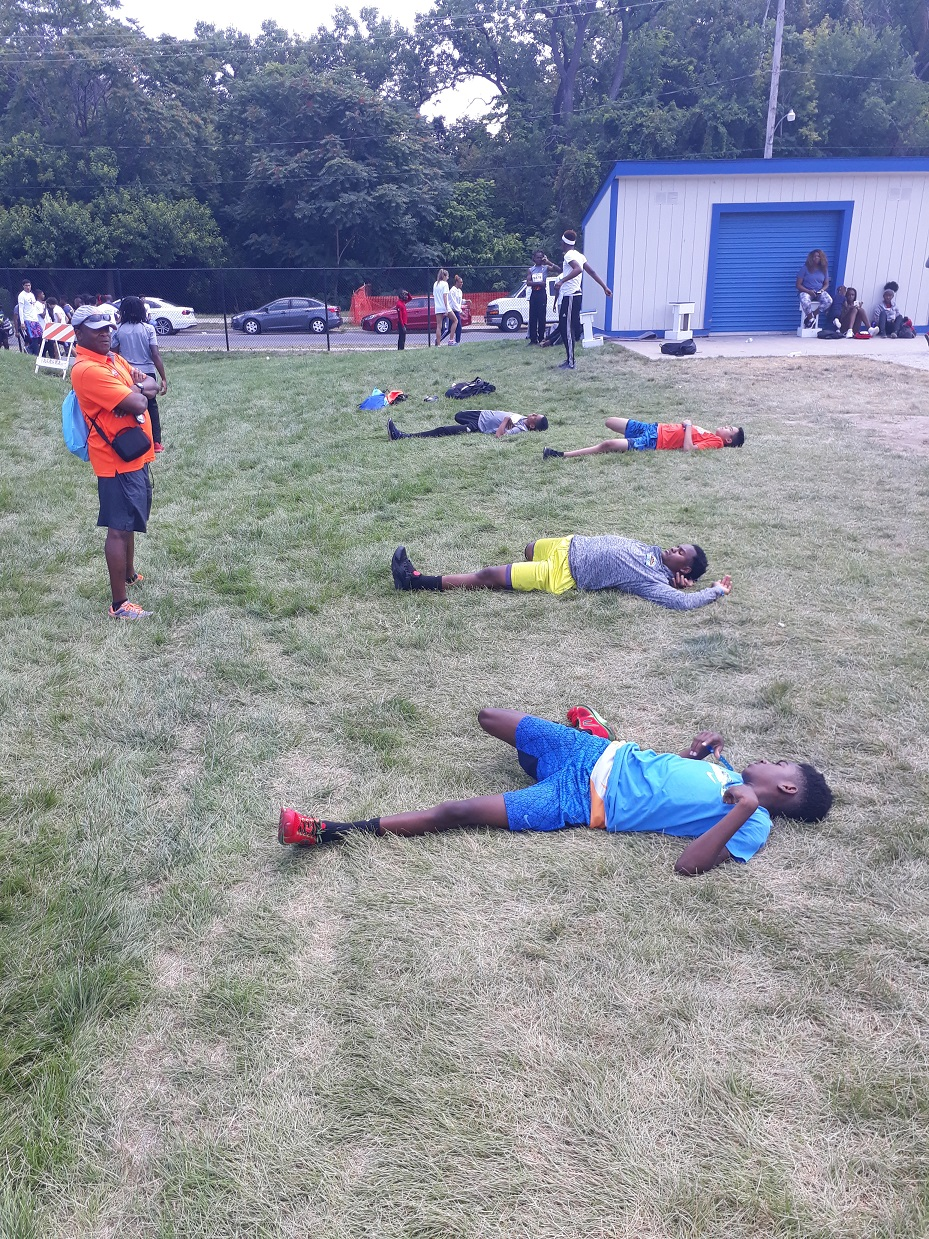 4x400 team stretching before the big race
