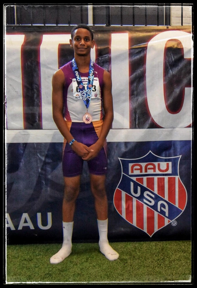 Isaiah with his 4x800 medal