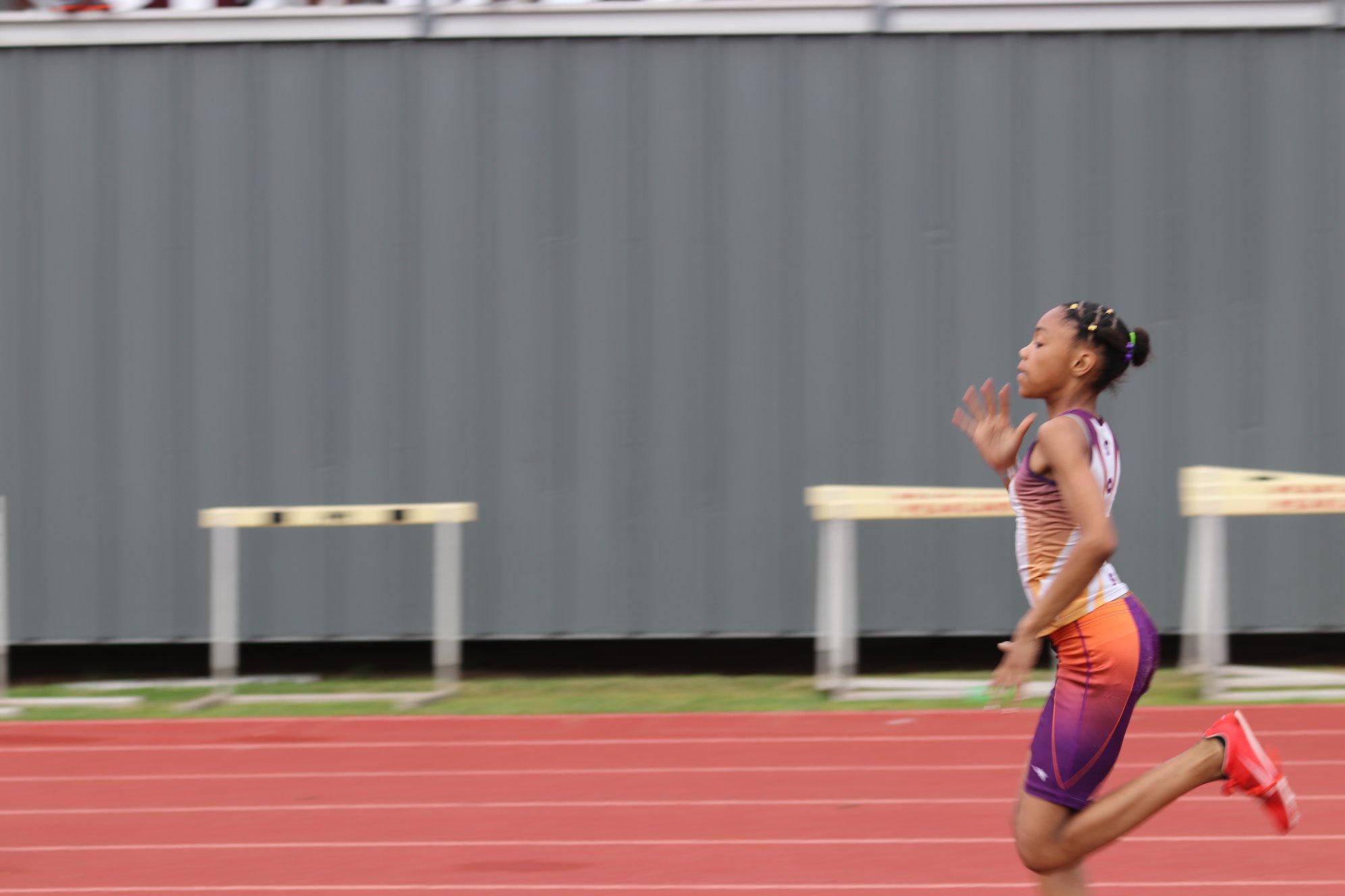 Jayla running the 100