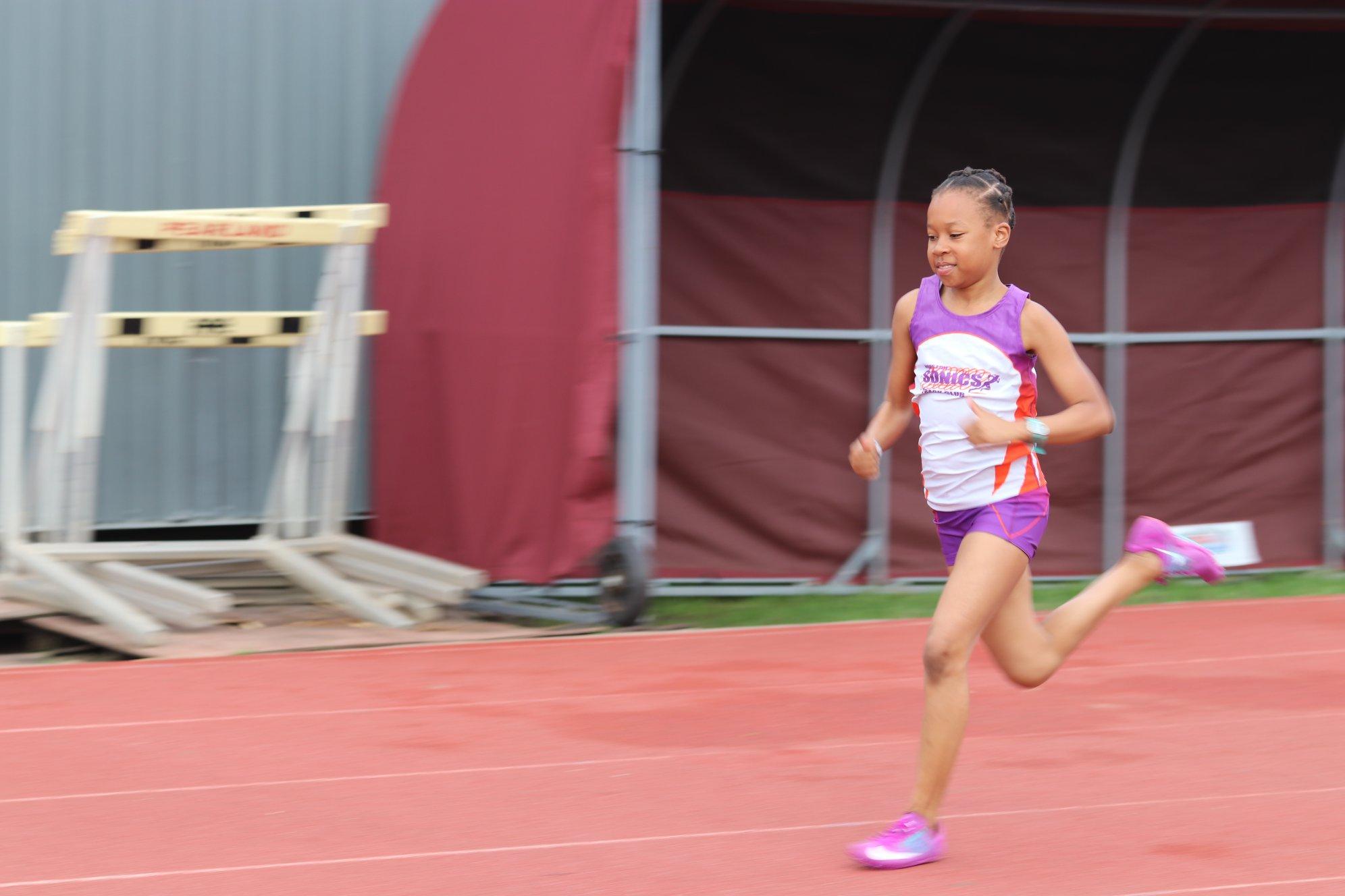 Natalie running the 100