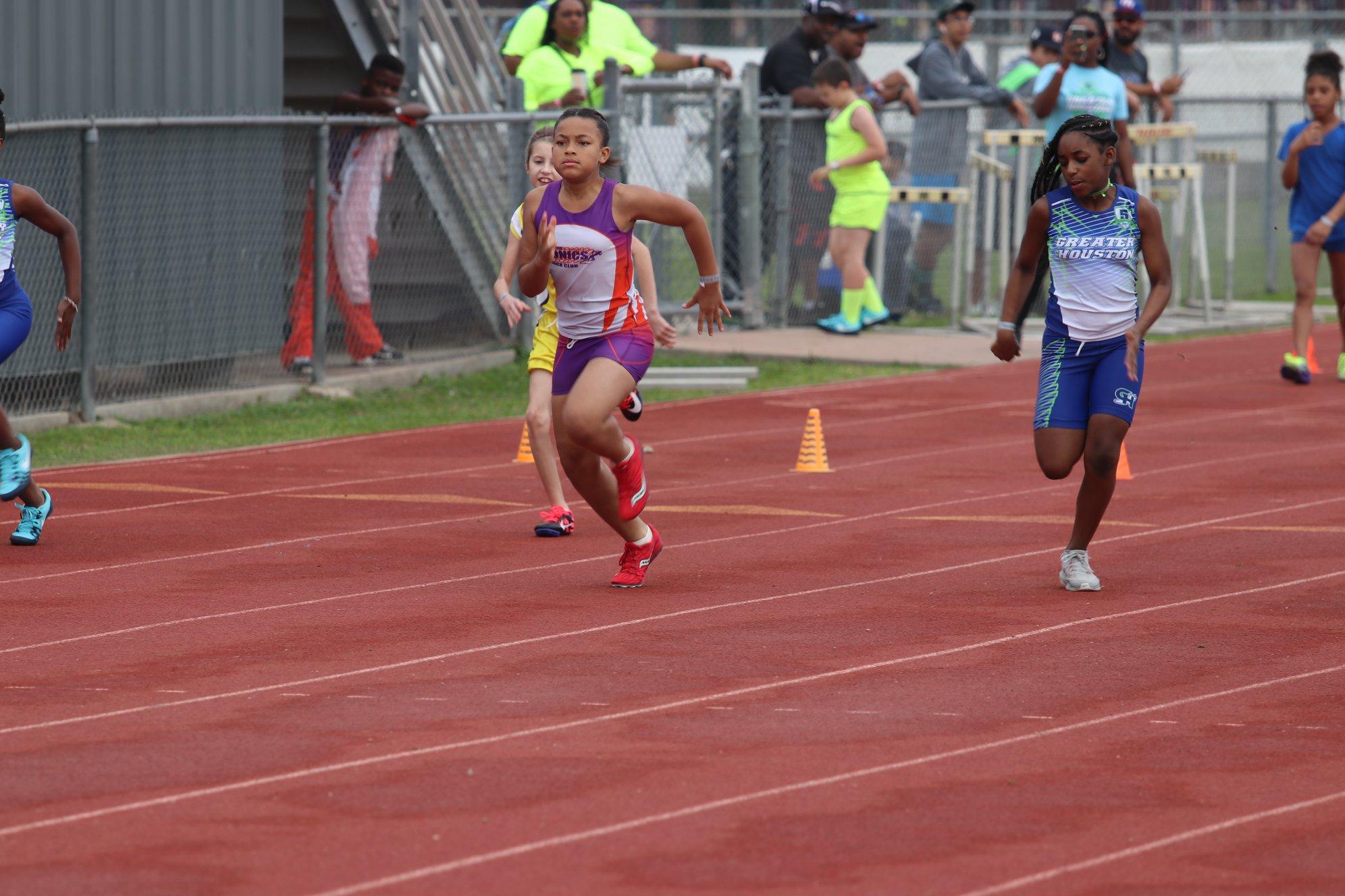 Sydney running the 100