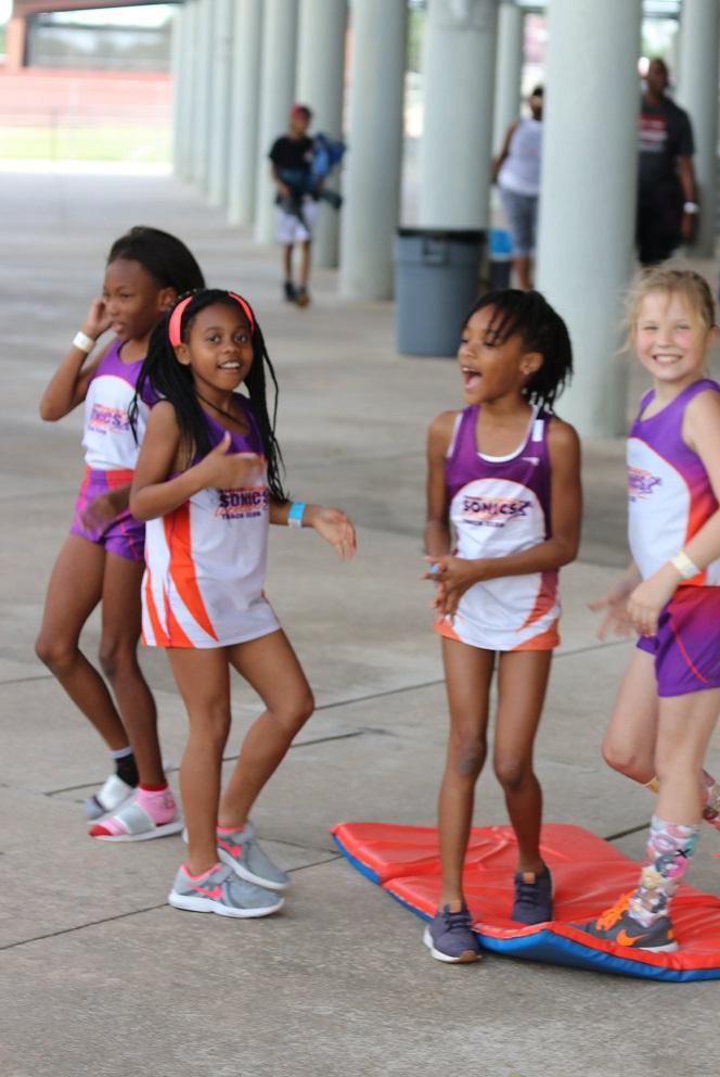 Girls having fun between events