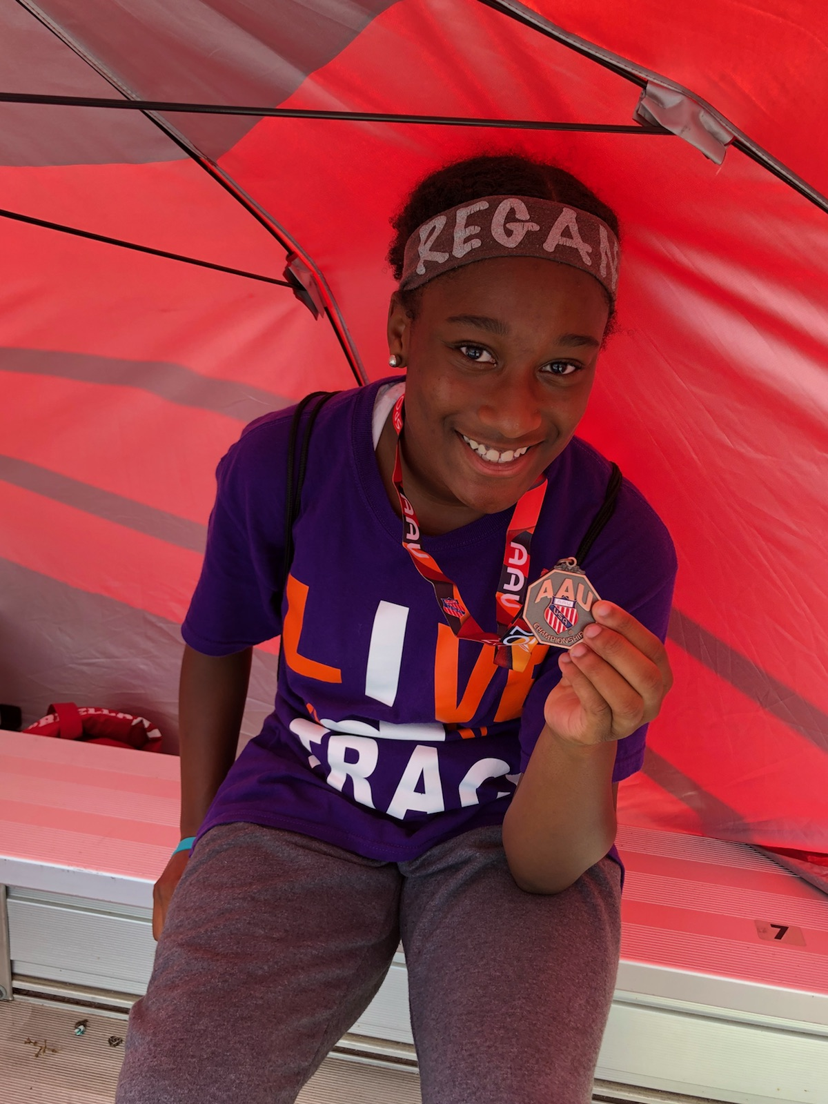 Regan showing off her medal in the  200m hurdles