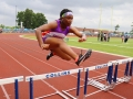 Regan running the 100m hurdles